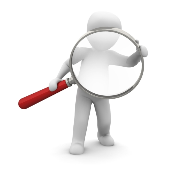 image of a person holding a giant magnifying glass