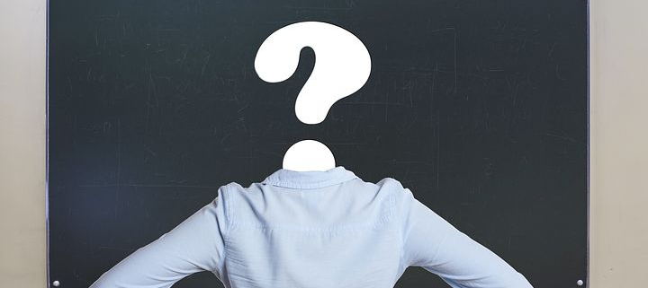 a picture of a teacher with a question mark in place of her head